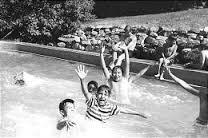 Children enjoy the swimming pool at St. Ann's Retreat in Logan Canyon